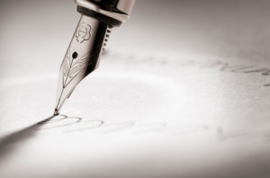 Pen signing a paper