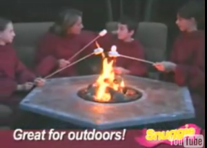Family of Snuggies around a fire