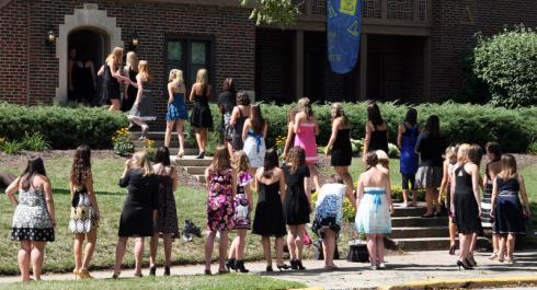 girls entering sorority house