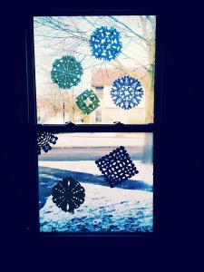 paper snowflakes on window