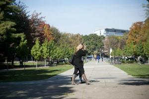 girl walking on Purdue campus