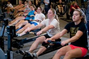 girls on rowing machines