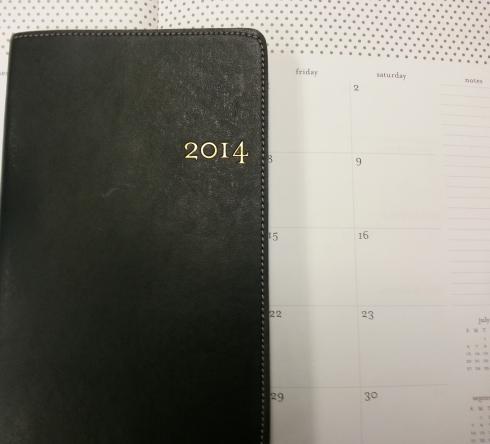 2014 planner on top of calendar
