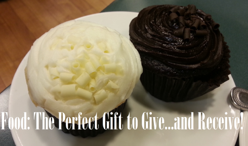 2 cupcakes on a plate: text overlay  Food: the perfect gift to give...and receive!