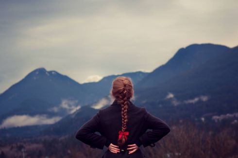 girl gazing at mountains