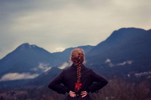 girl gazing at mountains