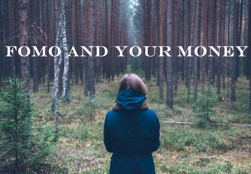 girl standing in woods; text overlay: FOMO and Your Money
